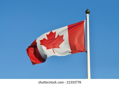 A Canadian flag waving in the wind.