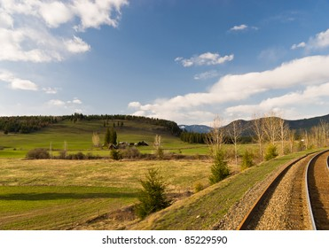 Canadian landscape in spring with rail tracks