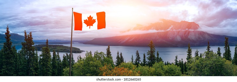 Canadian National Flag composite. Beautiful Panoramic View of Nature Landscape during a colorful cloudy sunrise. Taken in Yukon, Canada.