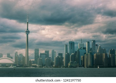 Canadian National Tower (CN Tower) surrounded by more modern buildings in downtown Toronto, Ontario