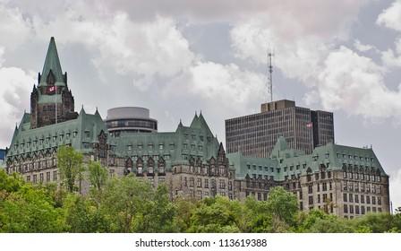 The canadian Parliament Confederation Building facing the Ottawa river in Ottawa, Canada.