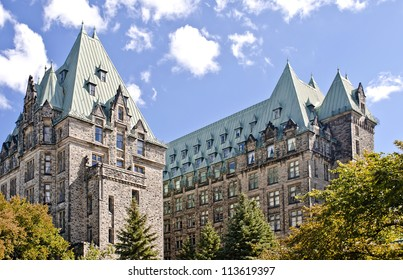 The Canadian Parliament Confederation Building seen from behind showing the 2 towers of offices for Members of Parliament in Ottawa, Canada.