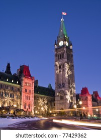 The canadian Parliament at dusk during the festive season.