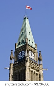 The Canadian Parliament Peace Tower with flag at noon in Ottawa Canada.
