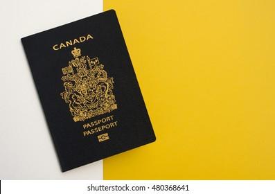 Canadian Passport White and Yellow Flat Lay