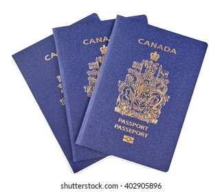 Canadian passports close-up and isolated over white background