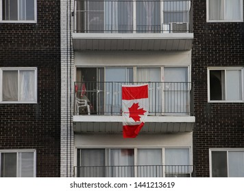 A Canadian photo of an interesting Canada Day Flag on a downtown building balcony in Ottawa, Ontario, Canada.