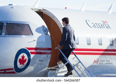 Canadian Prime Minister Justin Trudeau boards Can Force One in Calgary, Alberta to head to Saskatoon as part of his cross country tour on January 25, 2017