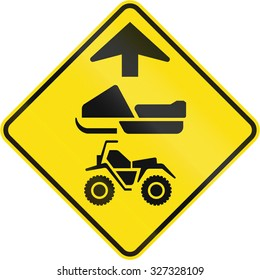 Canadian road warning sign - ATVs and snowmobiles ahead. This sign is used in Quebec.