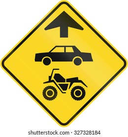 Canadian road warning sign - ATVs and cars ahead. This sign is used in Quebec.