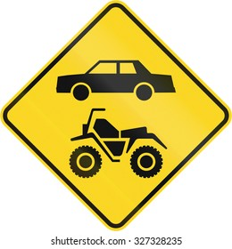 Canadian road warning sign - ATVs and cars. This sign is used in Quebec.