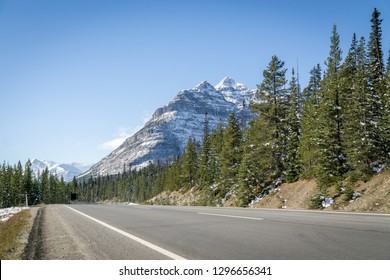 Canadian Rocky Mountain highway road at autumn sunny day, Alberta, Canada