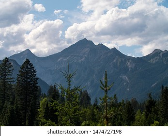 Canadian Rocky Moutains with trees and clouds