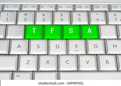 Canadian Tax-Free Savings Account spelled on metallic keyboard
