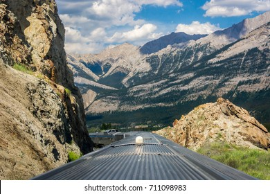 Canadian train traveling through the Rocky Mountains