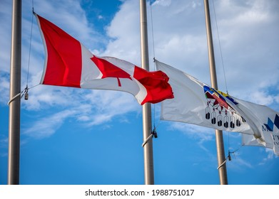 Canadian and Treaty 7 flags flying at half mast.