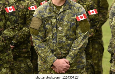 Canadian troops. Canadian Army. Canada flags on soldiers arm.