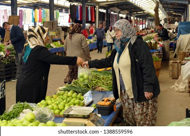 CANAKKALE, TURKEY - APR 21, 2019 -Buying vegetables in the central market of Canakkale, Turkey