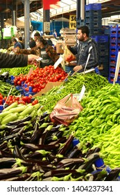 CANAKKALE, TURKEY - APR 21, 2019 - Buying vegetables in the central market of Canakkale, Turkey