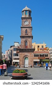 Canakkale, Turkey - August 12, 2013. Five-storey Ottoman clock tower in Canakkale, dating from 1897. View with people.