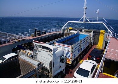 CANAKKALE, TURKEY - MAY 2, 2018 - Trucks on Gallipoli ferry crossing the Dardanelles near Canakkale, Turkey