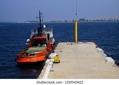 CANAKKALE, TURKEY - MAY 2, 2018 - Tugboat docked at wharf near the  Gallipoli ferry, Canakkale, Turkey