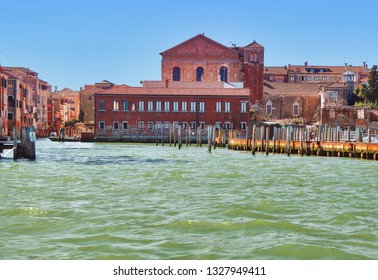 canal and abbey church view Venice Italy