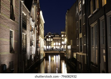 Canal in Amsterdam by evening