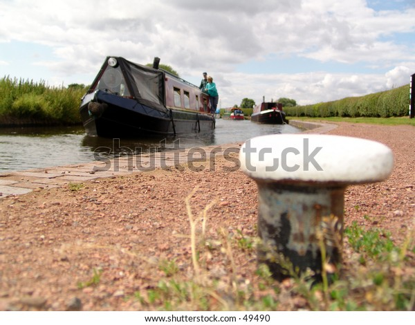 Canal barge and towpath with mooring