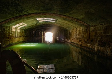 Canal below Place of Republic, Livorno, Tuscany, Italy - passage, tunnel under Place of Republic
