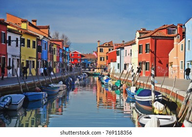 Canal with boats and colorful houses in the Burano island in the Venice, Italy