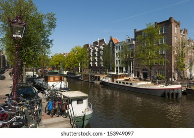 Canal boats and houses in Amsterdam