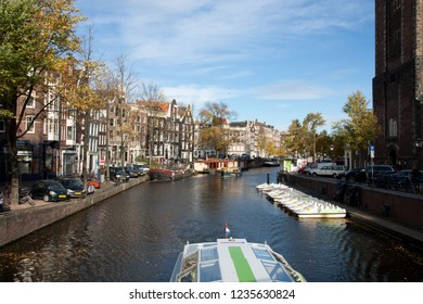 Canal, boats and houses in Amsterdam, Netherlands. Photo taken on 07 November 2018.