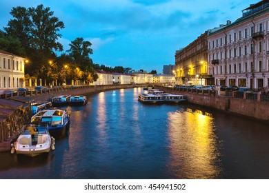 Canal with boats at night. St. Petersburg, Russia