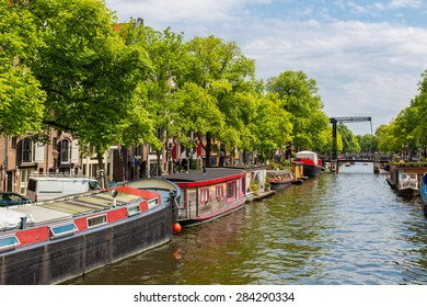 Canal and bridge in Amsterdam, Netherlands in a summer day