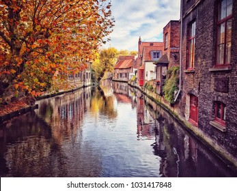 Canal of Bruges that surrounded by historical houses in Belgium