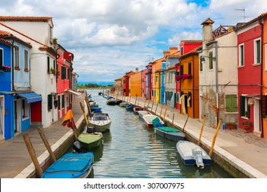 Canal with colorful houses on the famous island Burano, Venice, Italy