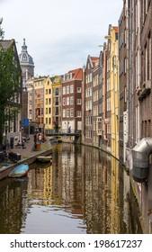 Canal in De Wallen district of Amsterdam