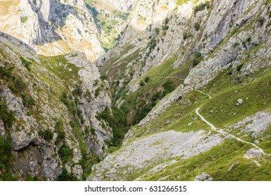 The Canal del Texu is a hiking trail and a passage way between the village Bulnes and Poncebos at the river Rio Cares. The trackway leads along the river Rio Bulnes, at the foot of the Picos de Europa