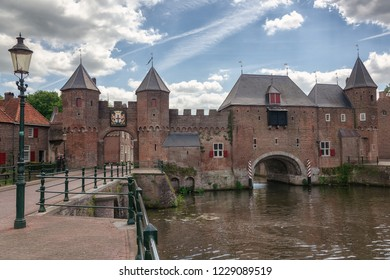 The canal Eem with in the background the medieval gate The Koppelpoort in the city of Amersfoort in The Netherlands