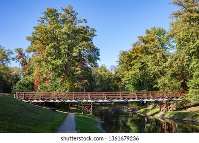 Canal with footbridge in Fort Bema park in Warsaw, Poland