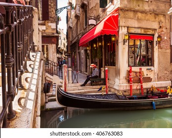 Canal with gondolas in Venice, Italy. Architecture and landmarks of Venice. Venice postcard with Venice gondolas