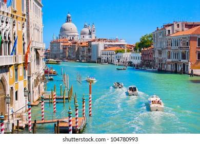 Canal Grande with Basilica di Santa Maria della Salute in the background as seen from Ponte dell Accademia, Venice, Italy