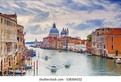 Canal Grande with Basilica Santa Maria della Salute in the background as seen from Ponte dell Accademia, Venice, Italy