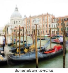 The Canal Grande with gondola, gondolier and Santa Maria della Salute.