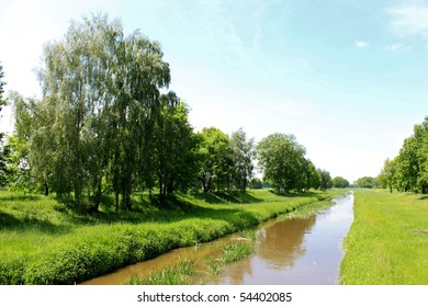 canal and green trees