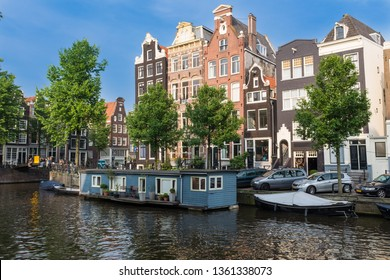 Canal Houses and blue boat house on Herengracht in Amsterdam