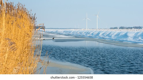 Canal with ice and water in winter