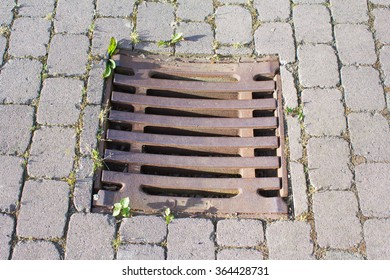 Canal lid on the street in Germany