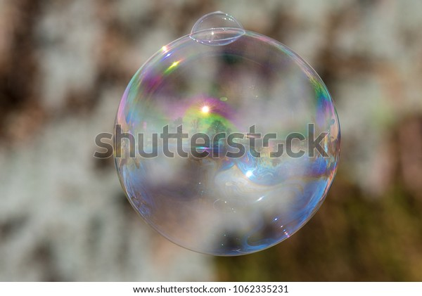 canal narrow boat with large soap bubble in fun and colorful image